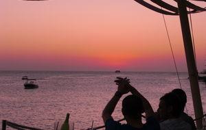 Solnedgång vid Cafe del Mar / Mambo